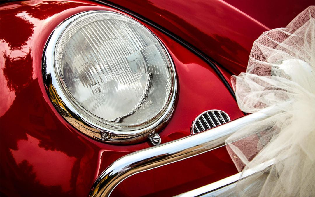 red car with white bow on it - a gift