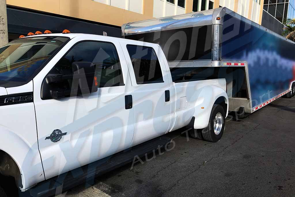 enclosed car trailer pulled by dually truck