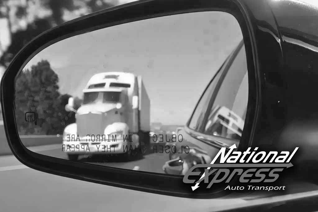 auto transport truck in rear view black and white
