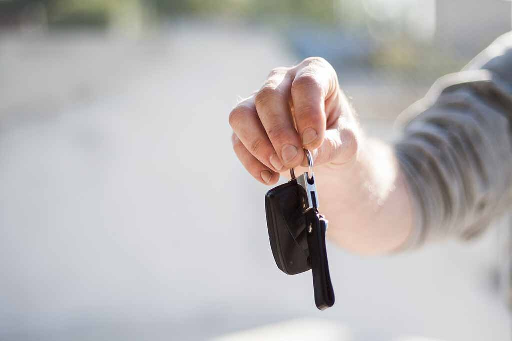 dealership giving keys to customer