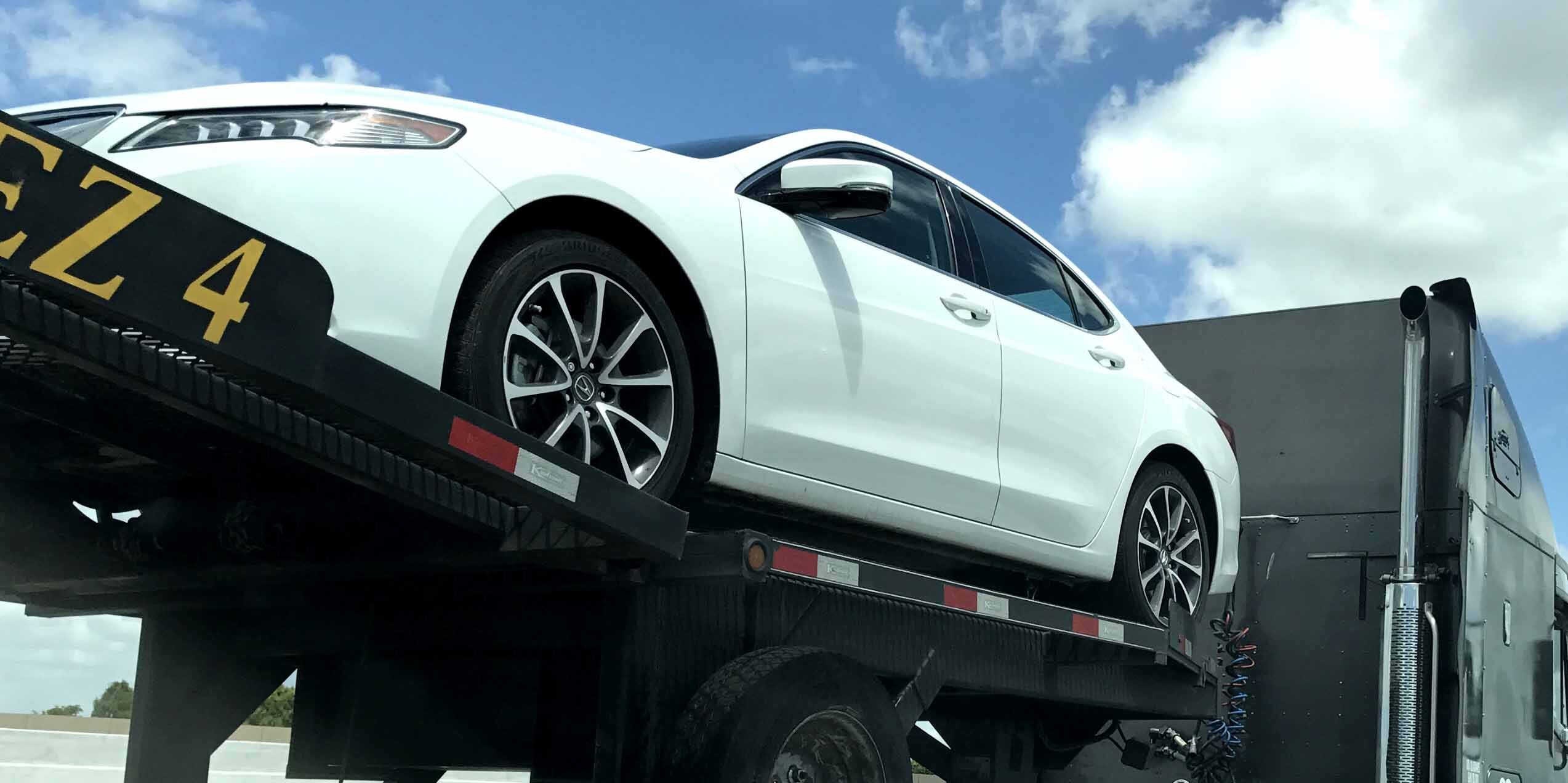 car on auto transport carrier